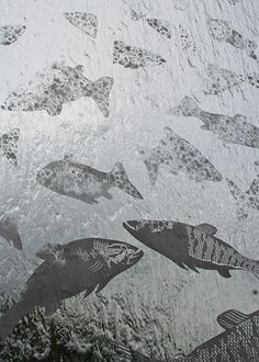 Custom fish design on a stainless steel water wall