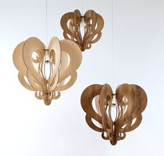 Australian designer Loz Abberton creates what she feels is an efficient take on the chandelier. These Grandeliers are made with the environment in mind – locally produced, flat packed for ease of shipping, FSC sourced Tasmanian Oak and Blackwood – inspired by the creation of transformative shadows and functional as either pendant lights or floor lamp shades
