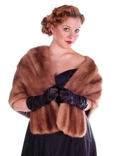 Gorgeous vintage mink stole in Autumn Haze color from an exquisite Pennsylvania Estate collection. It has a shawl collar, and is lined in taupe silk satin damask. The collar hides two front pockets. I