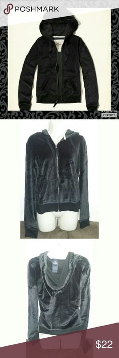 🍉OFFER $20🍉Hollister Black Velour zip up sweater Black Velour zip up sweater. Size large. New with tags. Has Hollister metal embellom on pocket. Bet comfortable soft material. 77% cotton 23% polyester. Perfect Valentine's day gift. Hollister  Tops Sweatshirts & Hoodies