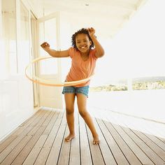 Look for a hoop that reaches your kid's belly button when the hoop is stood on end in front of her, says Cara Zara, a hoop-dance teacher in Charlotte, North Carolina. Your child should put one foot slightly in front of the other, place the hoop on her lower back, wind it up, and let it spin. Teach her to rock back and forth (from front to back) with her hips rather than moving in a circle.                 Originally published in the September 2012 issue of Parents magazine.