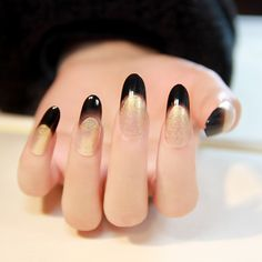 Beautiful black and gold oval nails