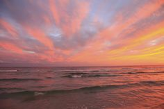 Sunset on the beach at our luxury hotel in Destin Florida.