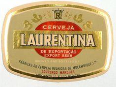 LAURENTINA 1957 - O rótulo em 1957. O rótulo em 1962.  Enquanto marca, a Laurentina teve um destino curioso, pois após a proclamação da Independência de Moçambique em meados de 1975, foi produzida durante alguns anos uma cerveja com a mesma designação e imagem mas fora de Moçambique (África do Sul e Alemanha). Miguel Buccellato, do grande clã Buccellato de Lourenço Marques, contou a história em 2004: