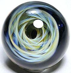 "GlassMaster James Yaun, Spiral Vortex A fumed marble with gold and silver. An extraordinary design with fine detail. Artist signed and approximately 2.32"" diameter."