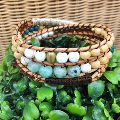Triple Wrap Bohemian Bracelet  Authentic Gemstones: Chrysocolla Howlite Fresh Water Pearls   Handmade  Local Jewelry! --- Available to purchase on Etsy at wanderlustwrists.etsy.com  #bracelet #bracelets #handmade #handmadebracelet #handmadejewelry #local #etsy #wanderlust #travel #explore #victoria #leather  #travelbracelet #crystalproperties #healing #bohemian #jewelry #wrapbracelet #chanluu #christmasgift #stockingstuffers #chrysocolla #howlite #freshwaterpearls #pearls #shopetsy…