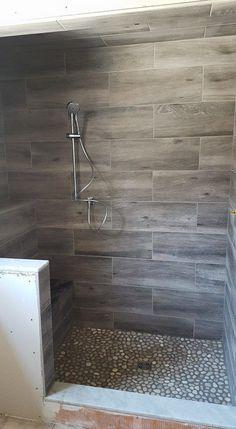 COOL wood grain porcelain shower and river rocks! (Stephen Belyea, Ma)