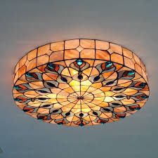 Artful Home Decorating Ideas Using Stained Glass Panels. In past centuries, stained glass panels were used to create pictorial stories in cathedral windows Stained Glass Lamp Shades, Stained Glass Light, Stained Glass Panels, Stained Glass Patterns, Tiffany Chandelier, Tiffany Lamps, Mosaic Glass, Glass Art, Different Light Bulbs