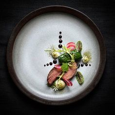 Pork tenderloin, mangold with rice, celery, beetroot, herbs.