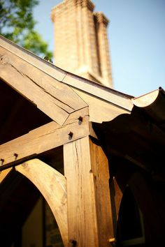 The construction is timber frame with mortise and tenon joints. The pegs you see here are wooden, and the gutters, like the roof, are copper...