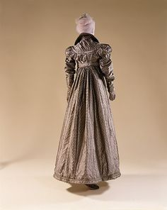 1815 Pelisse Generally full length and followed the typical Empire silhouette. metmuseum.org