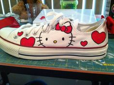 Hello Kitty Converse. Hello kitty and hearts hand-painted on one side, 'Hello Kitty' on the other side of shoe. Red bow added to the back. Available @etsy.com/artsy283 for $115
