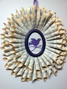 Rolled Book Page Wreath Tutorial. Lovely variations on the book page wreath - some holiday as well.