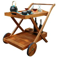 Indoor/outdoor wood serving cart with bottle holders and a removable tray. Product: Serving cart Construction Mat...
