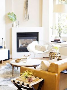 Modern loft rental updates | midcentury coffee table + faux fireplace front to hide ugly tile | Erin Hiemstra of Apartment 34