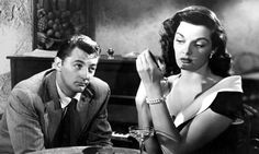 """Dan Milner (Robert Mitchum): """"Do you mind if I join you?"""" // Lenore Brent (Jane Russell): """"Seems you have."""" -- from His Kind of Woman (1951) directed by John Farrow"""