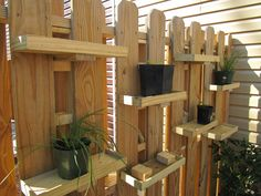 DIY plant shelves for a garden fence. Good idea if you have dogs that like to dig in your plants!