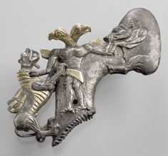 Central and North Asia, 8000-2000 BC. Shaft-hole axhead with a bird-headed demon, boar, and dragon