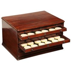 19th Century Eight-Drawer Box of Plaster Seals | From a unique collection of antique and modern historical memorabilia at https://www.1stdibs.com/furniture/more-furniture-collectibles/historical-memorabilia/