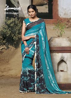 Beautiful prints on light sea green Georgette saree is made the difference!