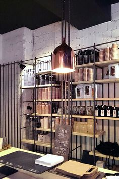 COFFEE SHOP | Bear Market Coffee Shop by VAV Architects | Industrial look | Copper light | Iron Bars | Black & White