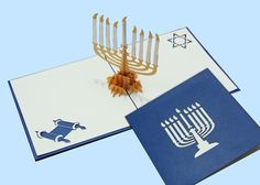 A beautiful blue and white Hanukkah Menorah card to celebrate the holidays #LovePopHoliday