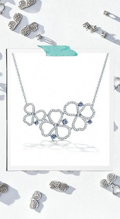 71d984c0ec3 Tiffany Paper Flowers™ diamond and tanzanite open cluster necklace in  platinum.  tiffanyjewelry Initial