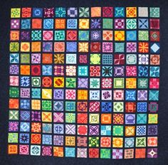 """""""Aloha Jane"""" (Dear Jane) quilt, hand pieced by Susan Crowder Cyr in a wide variety of batik fabrics. Tidewater Quilters' Guild Virginia (TQGVA)"""