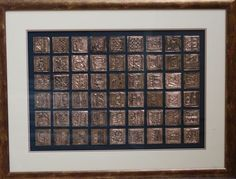 Etched copper squares matted and framed. 7th grade auction project.