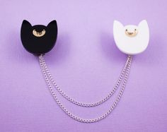 """Minimalistic Luna and Artemis collar clips that will make you feel like you have magical cat guardians IRL. 