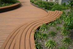 """Contractor shout out: TrexPro Gus de la Cruz of @barrettoutdoors in New Jersey built this deck titled """"The Outdoor Classroom"""" at the New York Hall of Science with Trex Transcend decking in Tiki Torch. Find a local TrexPro at for your next home or commercial project at http://www.trex.com/find-a-contractor/. #contractorproject #outdoorliving #deck #patio #porch #compositedecking"""