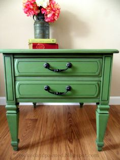 "This is from: Picked and Painted. She said ""I used Clivenden Pasture by Valspar which can be found at Lowe's.  I used a black glaze to darken the green and sealed with wax.  Oil Rubbed Bronze spray paint was used on the original pulls."""