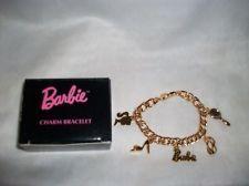 AVON BARBIE BRACELET CHARM 5 GOLD CHARMS SHOE GLASSES MIRROR JEWELRY NEW IN BOX