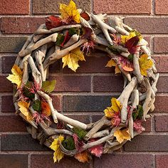 DIY Leaf-and-Berry Fall Wreath-glue pieces of driftwood or twigs to a Styrofoam wreath from local craft store. Then glue leaves, berries, acorns, etc throughout to add color and dimension.