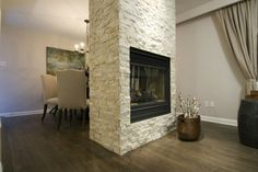 Would you put a fireplace in the middle of a room? #IncomeProperty #Design