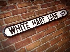 White Hart Lane Faux Cast Iron Old Fashioned Street Sign  * Hand Carved, Hand Painted Street Sign  * Made From Solid Timber, Not MDF  * Can Be Hung Or Free Standing (Fixings Not Supplied)  * Roughly 100cm x 15cm x 2cm  * Made To Order 5 - 7 Day Turnaround  Shipping  Your Choice of Courier Hermes - Standard  Hermes is fully insured and will generally arrive within 3 working days but can take up to 5 working days. Ideal for most deliveries however I understand certain properties can have…