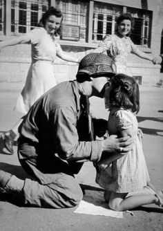 """""""Kiss of Liberation"""" An American soldier kissing a little Italian girl."""