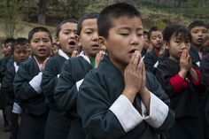 Local school children perform a prayer ceremony. Image: Conor_Ashleigh_-®2014