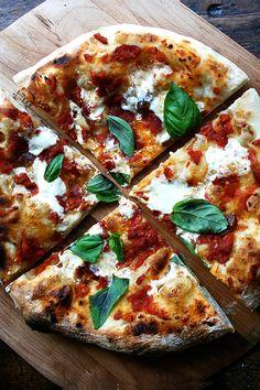Basil, burrata, oven-roasted tomatoes and garlic pizza