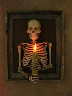 Framed 3D Skeleton Torso holding Candle
