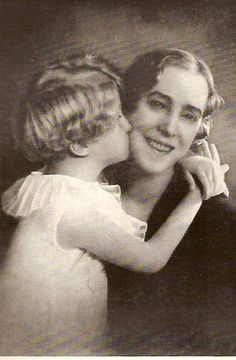 Prince Albert of Belgium, the Prince of Liege, future King Albert II, giving his grandmother, Queen Elisabeth a kiss