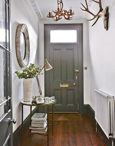 Wood floors, white walls, grey painted doors and skirting