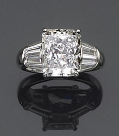 A diamond solitaire ring, Oscar Heyman & Bros.  the radiant-cut diamond, weighing 7.00 carats, with tapered baguette-cut four-stone shoulders and a plain mount; with maker's mark HB for Oscar Heyman & Bros, no. 152436; remaining diamonds weighing approximately: 2.00 carats total; mounted in platinum.