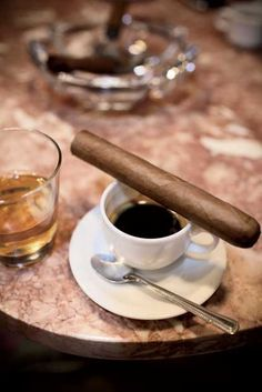 Rum & Cuban coffee with a freshly rolled stogie at Paratagas cigar factory in Cuba