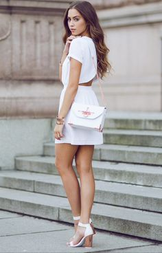 Step Out: Kenza is wearing an Ivey Revel dress with a cut-out back, shoes & bag by Angelica Blick for BikBok.