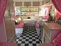 Love the inside of this retro camper. Vibrant floor makes a great setting for fun colors.