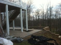 Wall tied into the steep bank and laying Hanover 4x8 pavers for the customers new patio