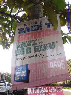 "(iklan English First di dekat Gereja Santo Matius, Pondok Aren)  Iklan kursus bahasa Inggris ini berbunyi ""back to school save up to 600 ribu"".  Saya agak ragu masukin anak saya ke sana, takutnya dia ngomong Inggrisnya mixed-mixed ... ;-)"