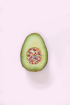 combination- the different colored sprinkles are combined and put into the avocado; a merging of two different materials