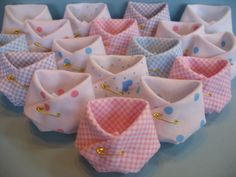 Baby shower favor idea - take a triangle of fabric, fold it like a cloth diaper and pin it with a small pin.  Fill with pink or blue mints.  How fun!